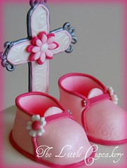 Close-Up fondant Cross and Baby Booties (TheLittleCupcakery) Tags: pink baby white cupcakes cross little baptism daisy christening booties tlc buttercream cupcakery xirj klairescupcakes