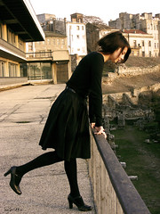 she moves her own way (hybrid's lollipops) Tags: old sunset urban woman brown black building rooftop girl fashion vintage dark hair clothing ruins warm highheels dress bend balcony over chick archeology 2009 anguish constanta pyha febraury pyhafreak