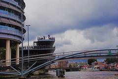 Amsterdam (janetfo747 ~ Dreaming of Africa) Tags: sky netherlands amsterdam bike ferry boats harbor canal worldsbest 5photosaday abigfave platinumphoto flickrestrellas multimegashot bestofthbest panoramafotogrfico