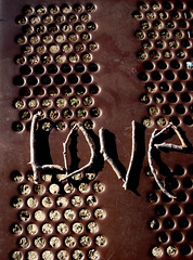 (Molly) Tags: brown love word sticks branches holes dots