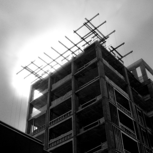 Looking up at a hotel under construction on the downtown mall of Charlottesville.