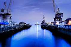 Two Cranes & Blue Water (briburt) Tags: ocean longexposure nightphotography blue texture water boston night evening harbor pier twilight dock lowlight nikon nightscape availablelight massachusetts cranes citylights photowalk charlestown bluehour transition shipyard drydock navyyard bostonist bostonharbor shipbuilding charlestownnavyyard d90 usscassinyoung lowlightphotography nikond90 nikon2470 northofnormal briburt ms2thdr nolanstern jimmike