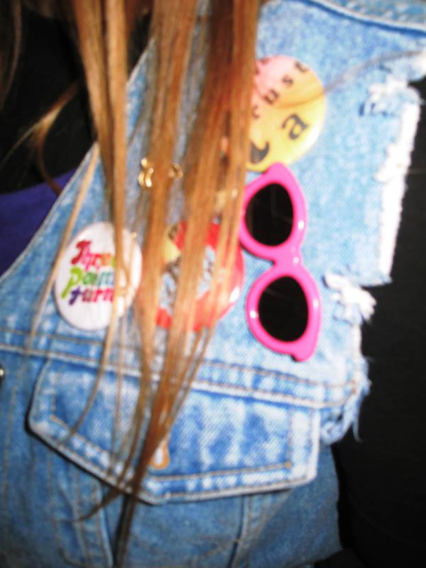 Badges on denim cut-off jacket, Biker style.