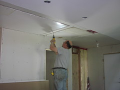 Steve screws ceiling wallboard