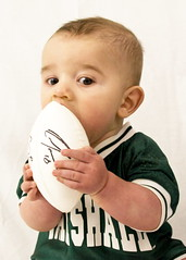 quintin eats football (Infamous J Wills) Tags: baby football marshall wv herd quintin