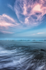 The flow of two ends (Mabmy) Tags: longexposure pink blue sunset sea cloud beach water colors canon singapore waves skies east sigma1224mm hdr eastcoast 1dx manualblending