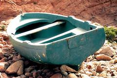 sad boat (R__C) Tags: italy boat barca italia pietre legno celeste vecchia arenata