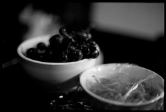 Snacks (gullevek) Tags: blackandwhite food fruits japan night geotagged tokyo golden shinjuku fuji bokeh grapes    iso1600 gai   olympusom2n fujineopansuperpresto1600 epsongtx900 zuikomc50mmf12 geo:lon=13970453 geo:lat=35694276 sexyfruits nipplesofgrapes