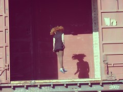 girl jumping boxcar
