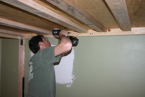 Attaching the bed to the wall