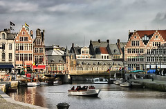 Belgium Memories (` Toshio ') Tags: bridge windows people history cars church architecture buildings reflections river boats boat colorful europe european belgium flags tourists belgian ghent europeanunion boatride flanders toshio korenlei platinumheartaward
