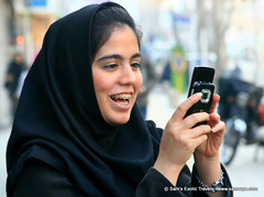IMG_2507 (Sam's Exotic Travels) Tags: camera people smile iran braces hijab cellphone tehran younggirl bokah