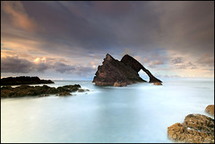 Bow Fiddle Rock #2 (angus clyne) Tags: rock night dark coast scotland boat town long exposure arch time harbour north scottish east sail moray firth colorphotoaward bowfiddlerock 100commentgroup saariysqualitypictures