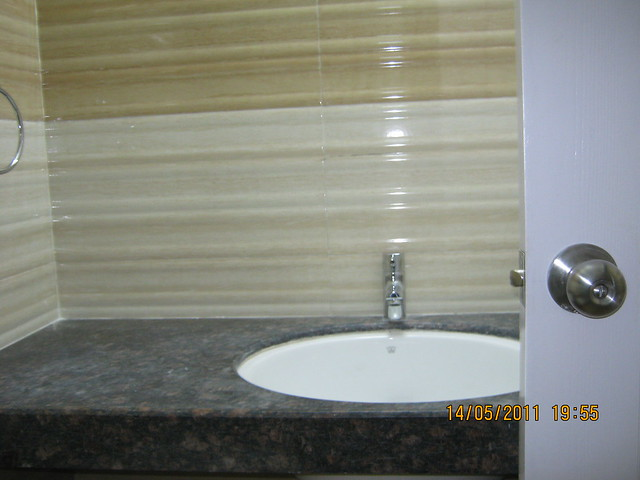 Granite counter washbasin (Master bedroom) in a 2 BHK Sample Flat in Om Developers' Tropica, Blessed Township at Ravet PCMC, Pune 412 101