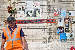 Happy birthday (Gary Kinsman) Tags: london se1 southwarkstreet southwark borough canon5d canon28mmf18 candid streetphotography streetlife unhappy builder constructionworker happybirthday erikrosero tribute shrine murder crime highvis bankside londonist 2011 people person