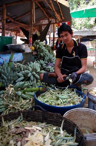 Young Thai Peeling Bananas