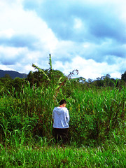 Nature's Call (Bernard M. Wong) Tags: travel blue sky mountains green pee car clouds back call colours going places visit sri study sarawak mind malaysia borneo thinking grasses roadside bushes loved ones natures aman selective wildly