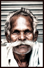 The Old Guy with Bold moustache (bhagath makka) Tags: street old portrait india white black art classic contrast nikon indian feel moustache special trips strong favourite tamil rugged bold freelance nadu makka thatha dutone d300 cs4 bhagath explored bhagathkumar oldmoustache makkaphotography wwwmakkaphotographycom