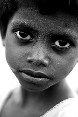look at me (Samir D) Tags: people bw india face canon eos 50mm eyes dof child explore heat kolkata 2009 potraits westbengal scorching brickfactory pricklyheat april09 40d canon40d facepotraits samird