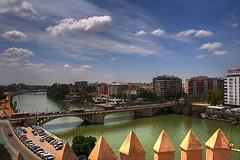 Desde la Torre del Oro (Zu Sanchez) Tags: bridge sky cloud tower rio river puente gold sevilla guadalquivir torre cielo nubes hdr oro losremedios