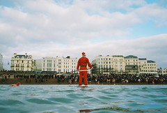 santa and the crowd (lomokev) Tags: santa christmas sea portrait people man cold male beach water sport swim fun brighton santas kodak crowd kodakportra400vc longboard fatherchristmas spectators portra christmasday longboarding kodakportra400 kodakportra deletetag nikonosv nikonos5 christmasdayswim eaglefestival roll:name=090107nikonusv christmasdayswim2008 file:name=090107nikonusv60 eaglefestivalsmall