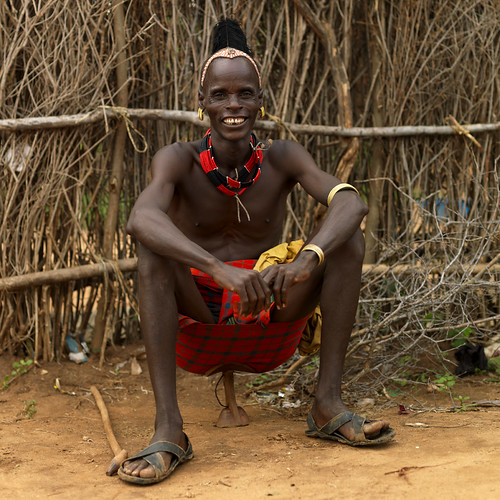 Hamar man sitting on his seat - Ethiopia