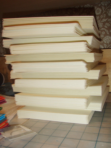 giant stack of folded, collated paper