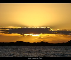 ARTIGO FINAL (Luciane Huffel) Tags: light sunset sky orange sun luz sol water rio gua clouds river laranja portoalegre cu prdosol porto nuvens alegre 2008 poa rs guaba gasmetro