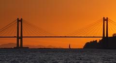 Rande. (benitojuncal) Tags: sunset españa simon sol praia puente spain san playa ponte galicia ensenada puesta islas pontevedra ria vigo rias velero cies rande baixas cesantes