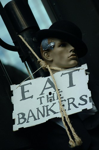 Protesters lynch a banker at the G20 protests.
