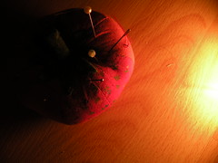the sun (melonscope) Tags: lighting red macro warm pins clear needles cushion tomoto