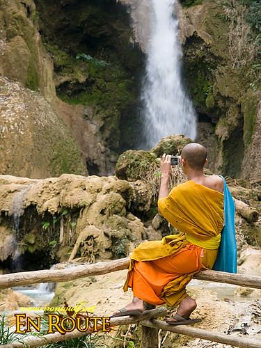 A monk shooting the falls at Laos