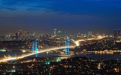 Bosporus Bridge and Business District of Istanbul (Yavuz Alper) Tags: longexposure bridge blue fog night downtown istanbul sis bosporus camlica