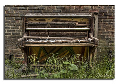 Piano ............. one careless owner.