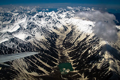 Lake Saiful Muluk in Karakoram (Lil [Kristen Elsby]) Tags: pakistan mountain lake snow mountains topf25 clouds plane airplane landscape flying inflight asia aircraft flight wing aerial alpine getty karakoram pia topv4444 alpinelake gettyimages southasia airsafari saifulmuluk karakoramrange lakesaifulmuluk gilgitbaltistan gettyimagesonflickr canong12