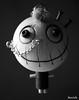 Smile (Luca Morlok) Tags: original bw valencia smile face monster toy punk emo souvenir balckandwhite gift sorriso ritratto originale regalo viso biancoenero mostro gioco legno faccia ricordo giocattolo