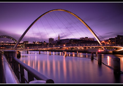 Millenium Bridge | Tyne Bridge 76 sec (Paul Santos Photography) Tags: longexposure bridge sunset england river newcastle purple steel samsung tynebridge milleniumbridge 1750 tamron northeast gx10 paulsantosportfolio