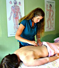 Sensing the locations for inserting the needles, Charlotte Stuart preparing to treat a patient with acupuncture moxibustion in Nelson, New Zealand