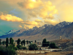 tashkurgan dramatics sunset (Csbr) Tags: 2005 china city travel sunset red summer sky sunlight mountain snow color yellow clouds photoshop landscape town ancient highway village border peak august valley xinjiang silkroad karakoram tajik himalaya centralasia canonixus400 pamir tashkurgan hindukush highplateau