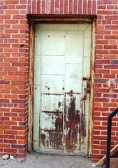 A New Door to Cross Through... (Julia TortoiseHugger) Tags: door brick oklahoma metal wall tile square rust university squares lock steel norman ok padlock crusty universityofoklahoma researchlab