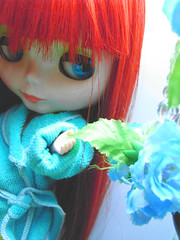 Thy flowers fall in my hands..