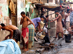 Sidewalk washing, Kolkata, India (Happy Sleepy) Tags: road street city urban india asia kolkata 2009 calcutta