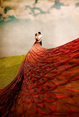 Spellbound (Lidia Camacho) Tags: wedding red two love beautiful clouds engagement rojo kiss couple dress wind pareja amor boda marriage happiness spell celebration pedro fairy dos fantasy dreamy session entrega embrace tale matrimonio abrazo vestido novios fairytales sueo enamorados masterclass deutschetelekom compromiso jesulina explored abigfave colorphotoaward invitedby