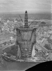 View from pulley-wheels of north side creeper-crane (jibbed right out) looking into box section of south side arch, Sydney Harbour Bridge, May 1930 / Ted Hood (hanging upside down 130 metres - 420 feet - above the harbour.)