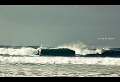 Living The Dream (Richard Trainor) Tags: uk chris ireland red sky beach point photography big waves break cloudy cassidy surfing windsurfing portrush windsurf magasine ir16