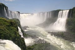 Iguacu Falls on the Brazilian side (chris.bryant) Tags: brazil sky sun mist sol southamerica nature water rio clouds river flow rocks afternoon bluesky spray rapids waterfalls cielo nubes cataratas geology picturesque soe rockformations sudamerica americadosul iguazufalls potofgold waterspray iguaufalls iguassufalls movingwater cataracts flowingwater blueribbonwinner cataratasdeliguaz cataratasdoiguau 5photosaday kartpostal mywinners abigfave powerfulwater platinumphoto anawesomeshot concordians viagginelmondo theperfectphotographer worldtrekker rubyphotographer panoramafotogrfico artofimages saariysqualitypictures flickrclassique