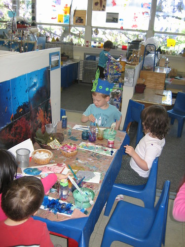 Painting with some of his preschool buddies