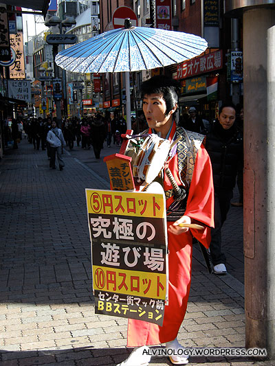 A performer hired to draw crowd to a newly opened pachinko store