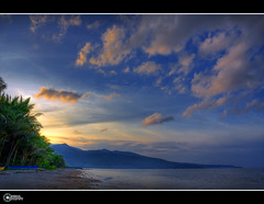 Canipaan  Dusk | Explore (rev_adan) Tags: blue trees sunset sea sky seascape beach water yellow clouds canon lens landscape boats island eos sand waves coconut dusk philippines explore shore kit leyte hinunangan 40d revadan vosplusbellesphotos canipaan