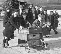 Getting ready for 5th November (theirhistory) Tags: wood boy fish girl hat kids docks children child boots jetty coat guyfawkes bonfire gocart trolly wellies salvage gummistiefel crates bonfirenight helpers fishboxes nationalchildrenshome